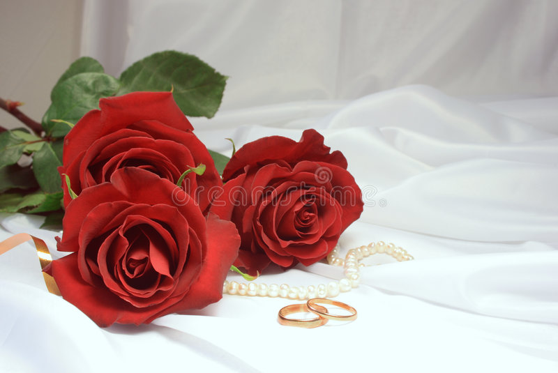 Download Roses And Wedding Rings Stock Photo