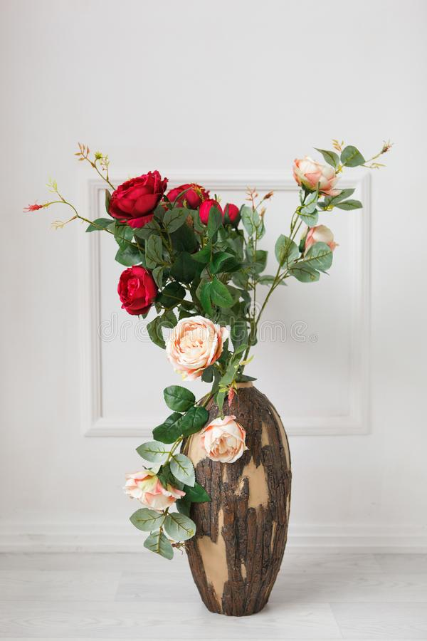 Roses in a wooden vase stock images
