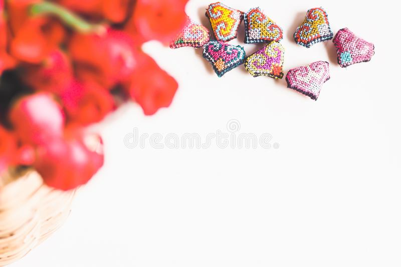 Roses on woven bamboo basket and handmade hearts, Valentines Day background, wedding day royalty free stock photo