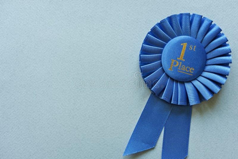 Rosetón azul del 1r lugar del campeón o de los ganadores fotos de archivo