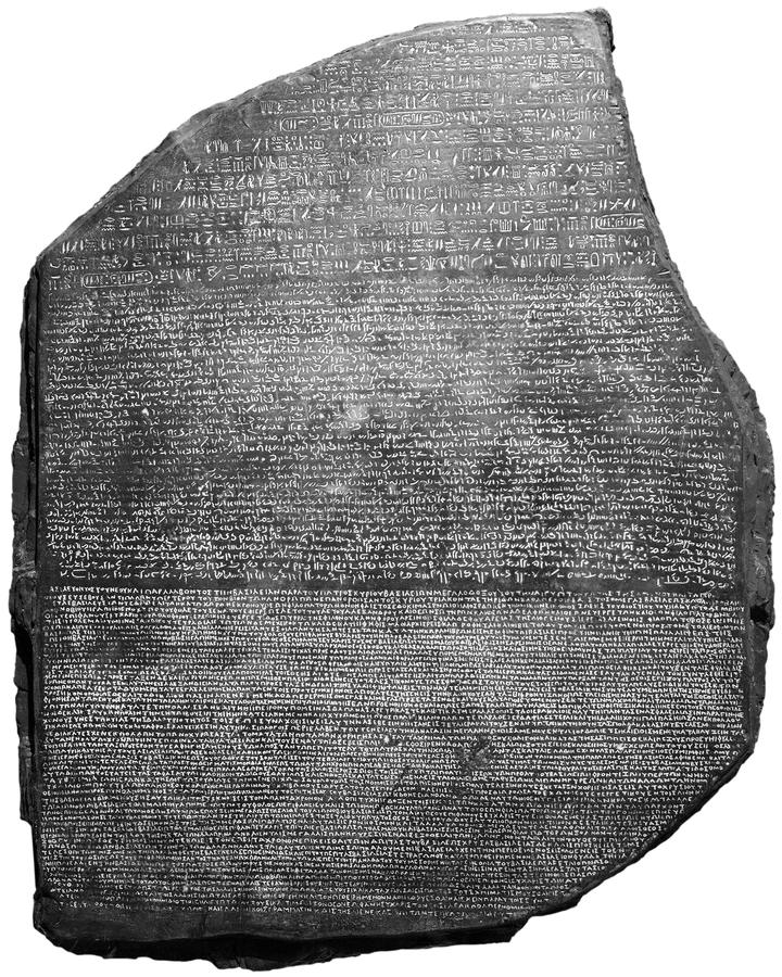 Rosetta Stone, Language, Archeology, Isolated. The Rosetta Stone, used to translate ancient languages. Translating a langue was the key with this ancient stock photo