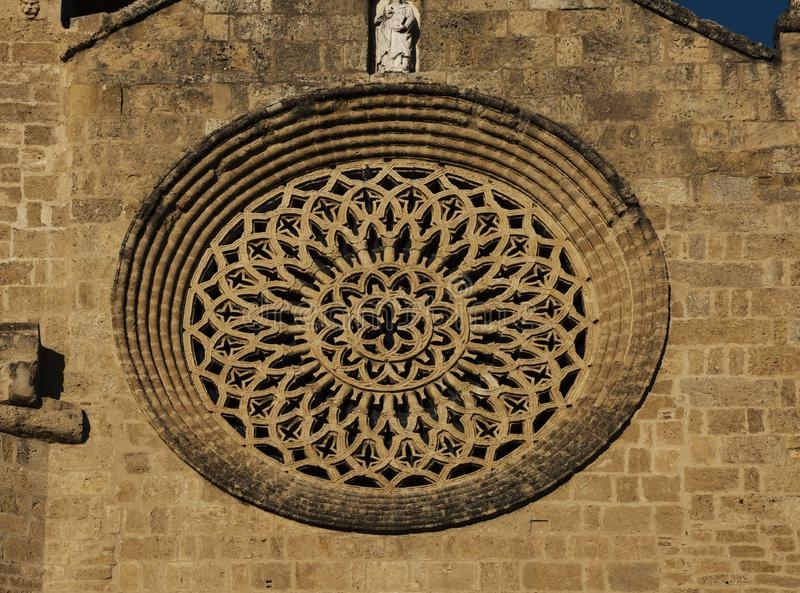 Rosette facade on the church. Shot in color rosette detail on the architecture of this historic building church. Set in Cordoba, Andalucia, Spain, Europe stock photo
