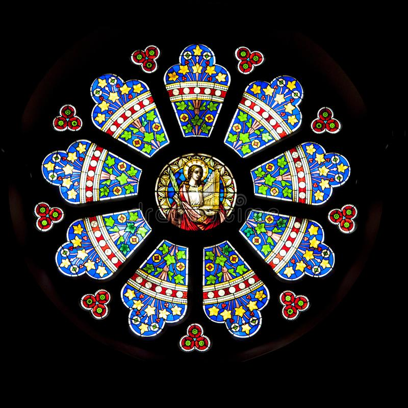 Rosette, geometric ornamental stained glass window, Church St. Lambertus, Mettmann, Germany. Beautiful bright ornamental stained glass window, St. Lambertus