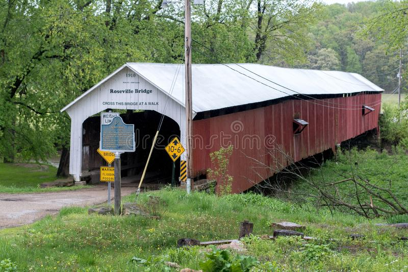 Roseville covered bridge in rural Indiana USA. Roseville Indiana USA, May 2 2019; The Roseville covered bridge was built in 1910, and spans the Big Raccoon Creek royalty free stock photo