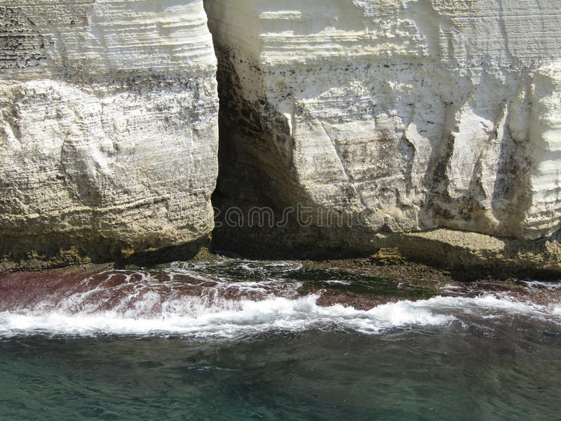 Stones rocks and cliffs on the sea in Rosh Hanikra Israel stock photography