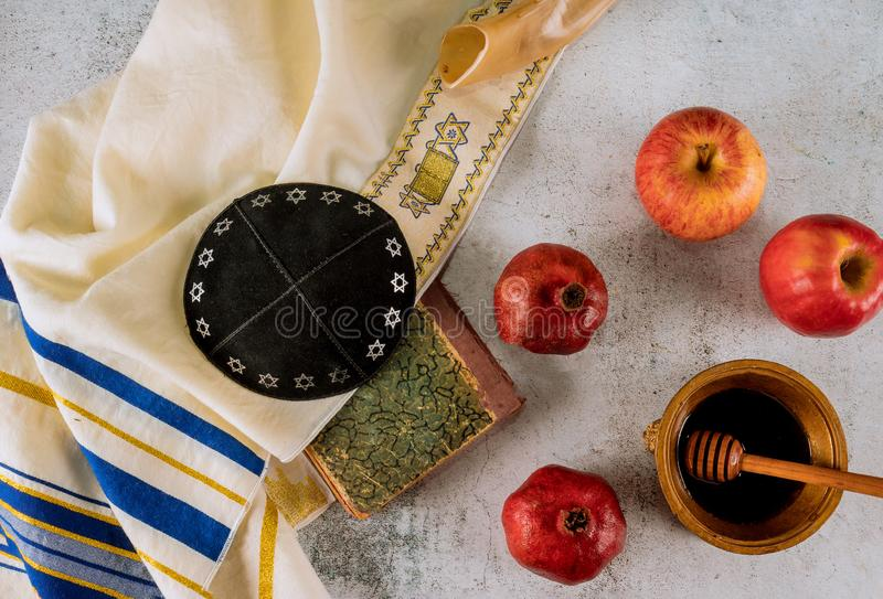 Shofar and tallit with glass honey jar and fresh ripe apples. Jewesh new year symbols. Rosh hashanah. Rosh hashanah with glass honey jar and fresh ripe apples stock image