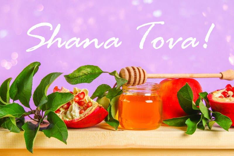 Rosh-hashanah jüdisches Neujahrsfeiertagkonzept Traditionelles Symbol Äpfel, Honig, Granatapfel Shana Tova lizenzfreies stockfoto