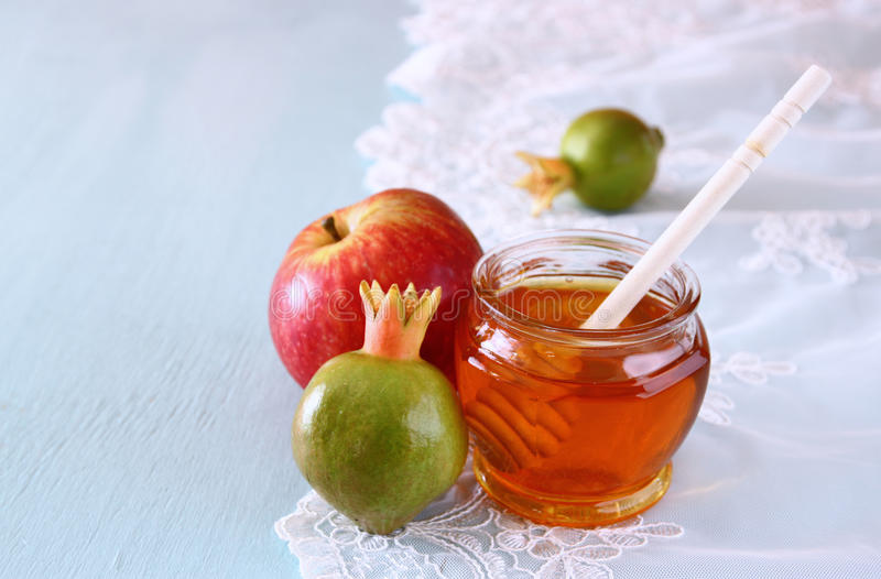 Rosh hashanah. (jewesh holiday) concept - honey, apple and pomegranate over wooden table. traditional holiday symbols stock photos