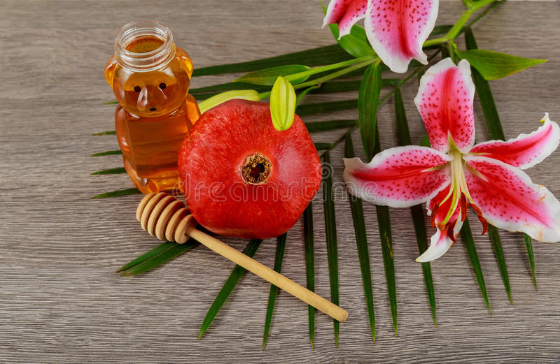 Rosh hashanah jewesh holiday concept - pomegranate honey pink lilies jewish food, symbol,. Jewish food, Jewish Holiday, Holiday symbol, rosh hashanah jewesh stock images