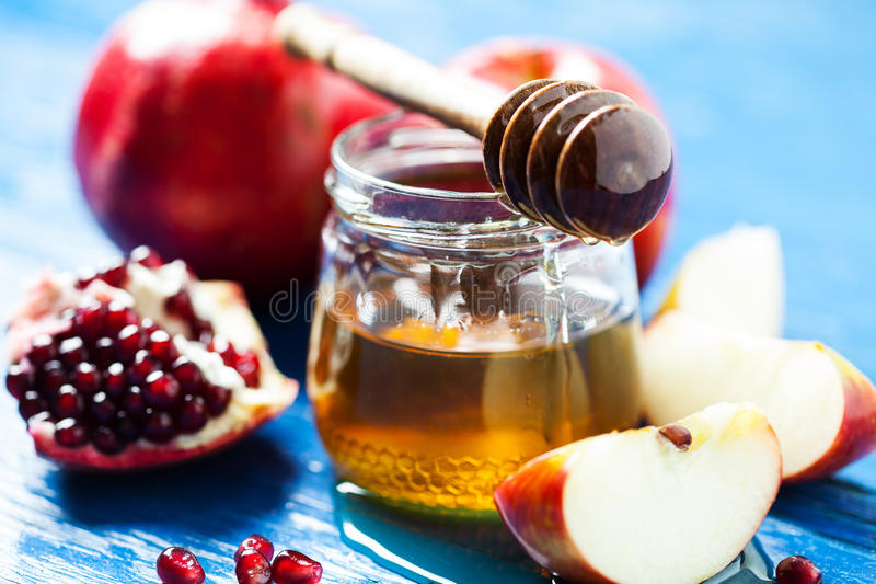 Rosh hashanah. Jewish holiday concept: honey, apple and pomegranate, with space for text stock photos