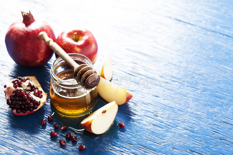 Rosh hashanah. Jewish holiday concept: honey, apple and pomegranate, with space for text stock image