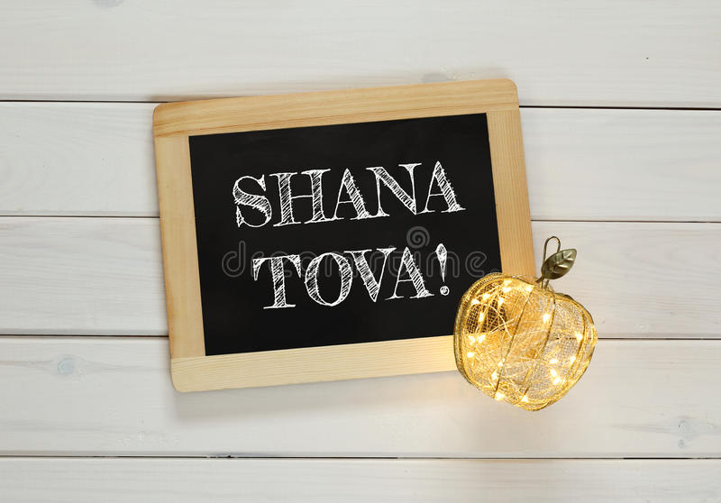 Rosh hashanah (jewish New Year) concept. Traditional symbols. Rosh hashanah (jewish New Year holiday) concept - blackboard with text than mean: Happy New Year stock photos