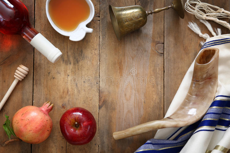 Rosh hashanah (jewish New Year) concept. Traditional symbols. Rosh hashanah (jewish New Year holiday) concept - shofar (horn), honey, apple and pomegranate over royalty free stock photography