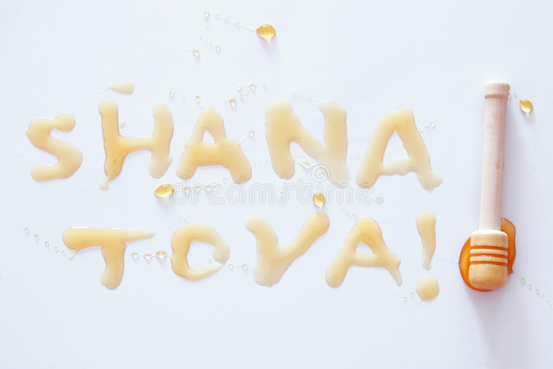 Rosh hashanah jewish New Year holiday concept. SHANA TOVA Text in hebrew that mean HAPPY NEW YEAR. On white royalty free stock photo