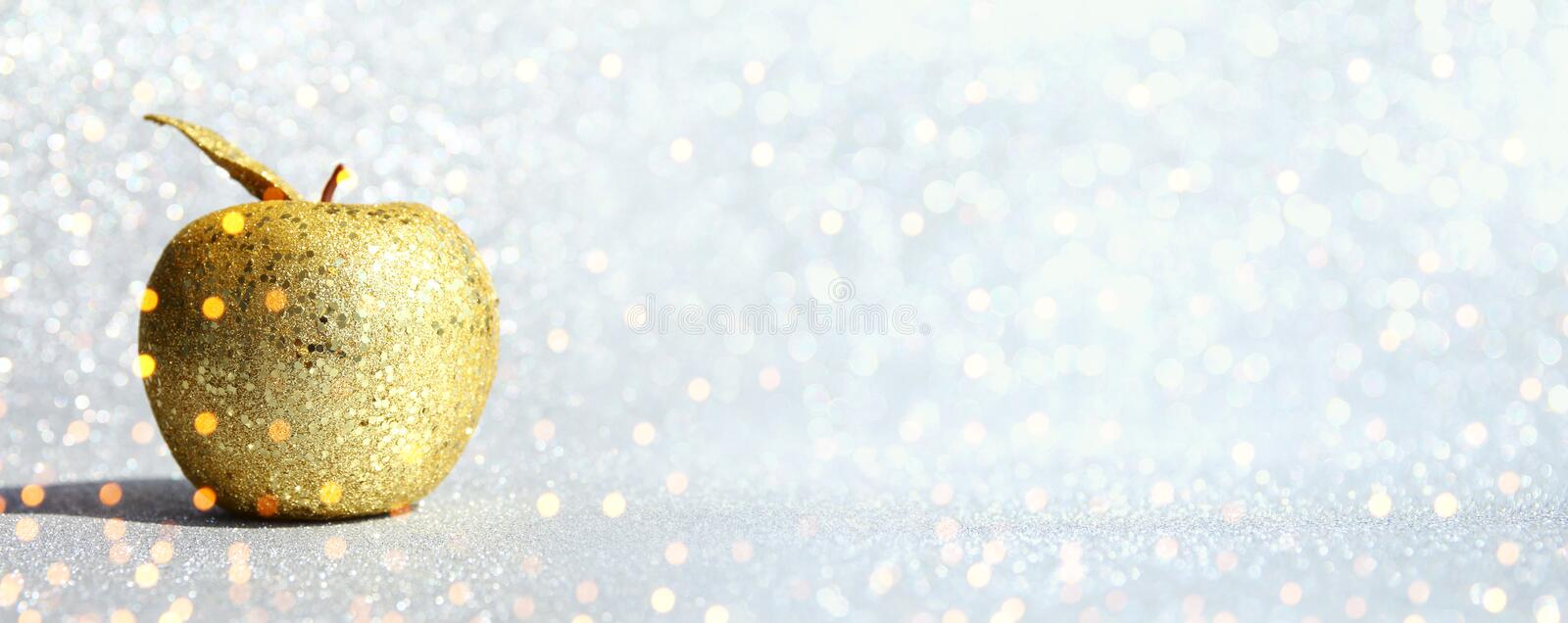 Rosh hashanah jewish New Year holiday concept. Traditional symbol, decorative glitter gold apple. banner.  stock photography