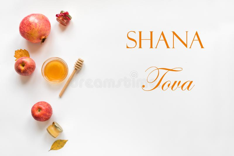 Rosh hashanah. Jewish New Year holiday concept. Creative layout of traditional symbols, top view, copy space royalty free stock photography