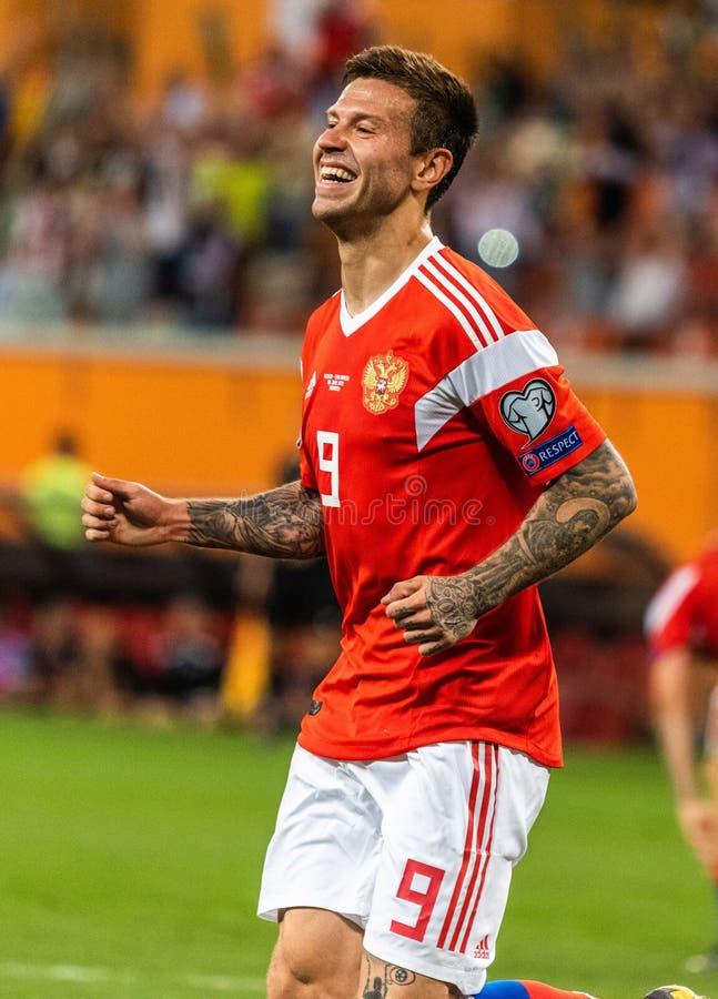 Rosja drużyna narodowa. strajkowicz Fedor Smolov świętuje jego cel ja zdjęcie royalty free