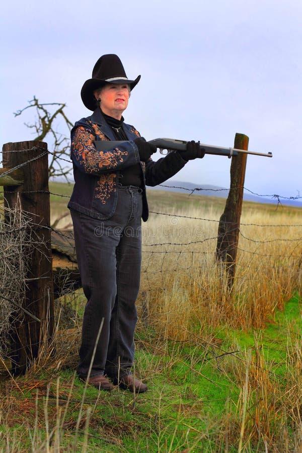 Rosnando a senhora Gunman imagens de stock royalty free
