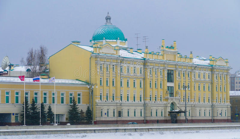 Rosneft - office at the Sofia Embankment in Moscow,. Flags, old mansion, winter, snow royalty free stock photos