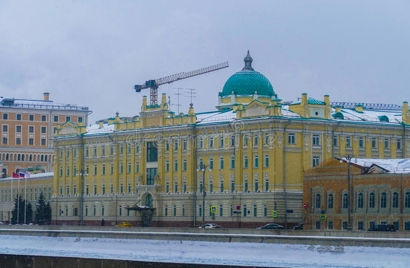 Rosneft - office at the Sofia Embankment in Moscow. Flags, old mansion, winter, snow stock photos