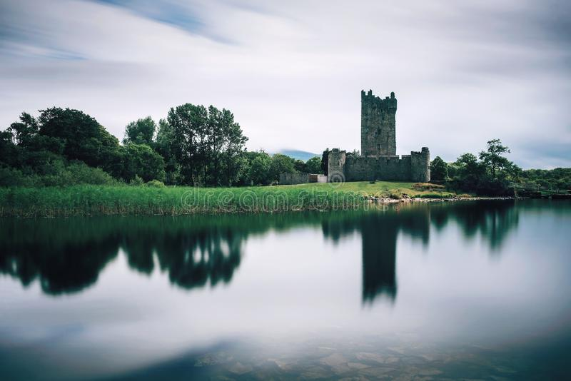 Ross Castle ruins in Ireland. Ross Castle ruins and the Lough Leane lake located in the Killarney National Park, Ireland. Long exposure royalty free stock photography