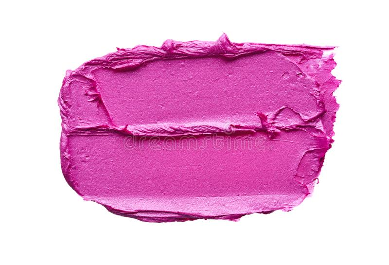 Rossetto rosa o pittura acrilica isolata su bianco fotografia stock
