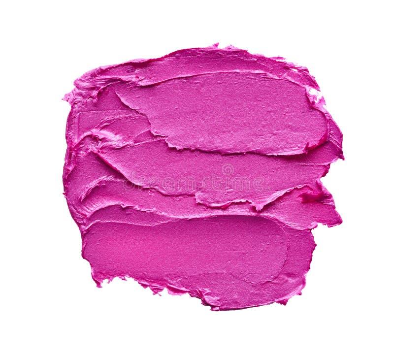 Rossetto rosa o pittura acrilica isolata su bianco fotografie stock