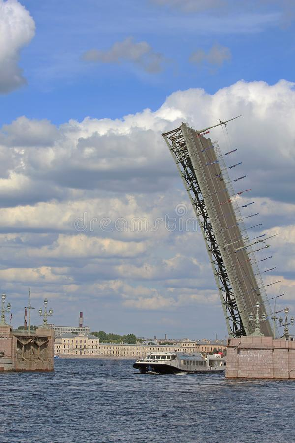 ROSSIA, St. Petersburg, the divorced Trinity Bridge. ROSSIA, St. Petersburg, the divorced Trinity Bridge, with a passing steamship floating beneath it stock photo