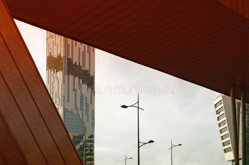 Rossing buildings of different shapes and colors - the details of modern urban architecture. Crossing buildings of different shapes and colors - the details of royalty free stock images