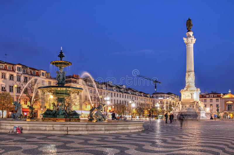 Rossio Square, Lisbon, Portugal. Night scene of Rossio Square, Lisbon, Portugal with one of its decorative fountains and column of Pedro IV royalty free stock images