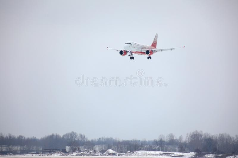 Rossiya - Russian Airlines Airbus A319-100 VP-BIS landing on snowy airport. Rossiya - Russian Airlines Airbus A319-111 VP-BIS landing on Munich Airport stock photography