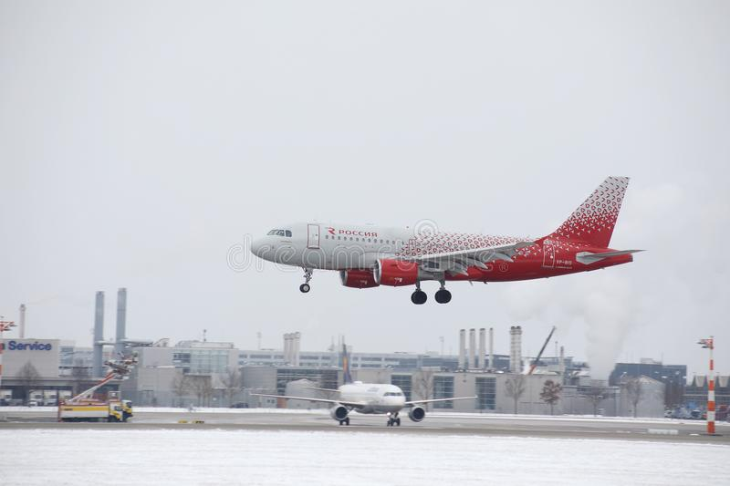 Rossiya - Russian Airlines Airbus A319-100 VP-BIS landing on snowy airport. Rossiya - Russian Airlines Airbus A319-111 VP-BIS landing on Munich Airport stock photos