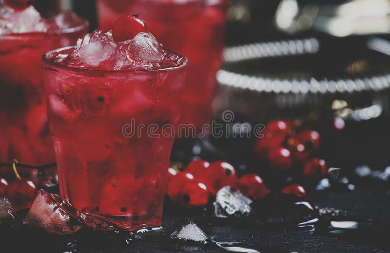 Rosso berry crash, alcoholic cocktail with red currant, vermouth. And ice, black background, selective focus and toned image stock photos