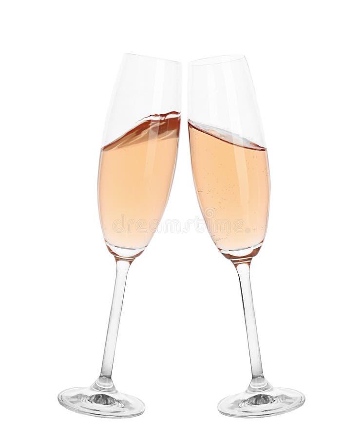 Rosta med exponeringsglas av rosa champagne arkivfoto