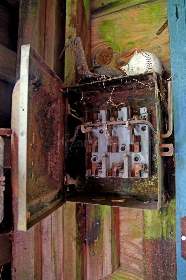 Rostad elektrisk panel royaltyfri fotografi