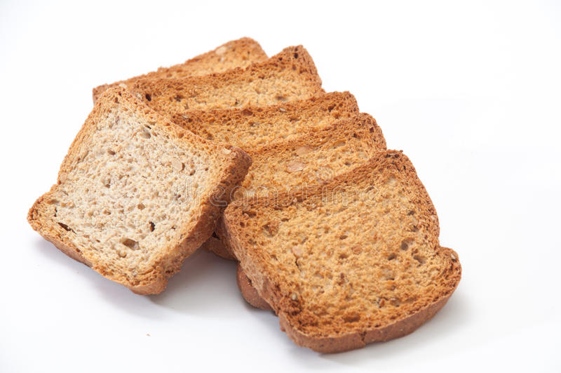 Rostat bröd på en vit bakgrund royaltyfri bild