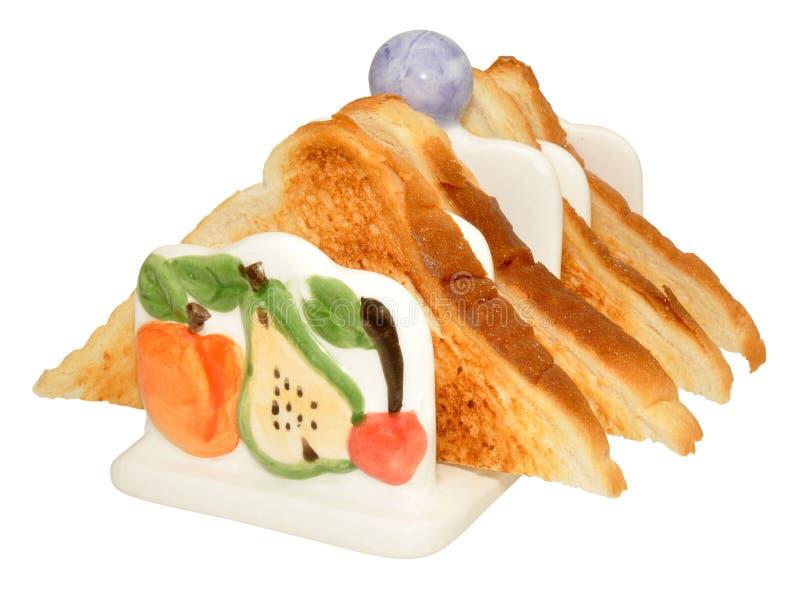 Rostat brödkugge som fylls med rostat bröd arkivbild