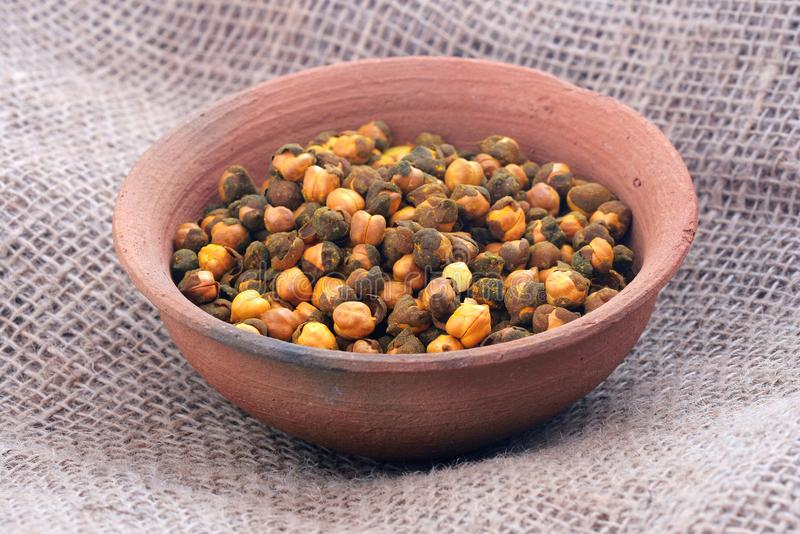 Rosted Gram. Or Chickpeas in bowl royalty free stock photos