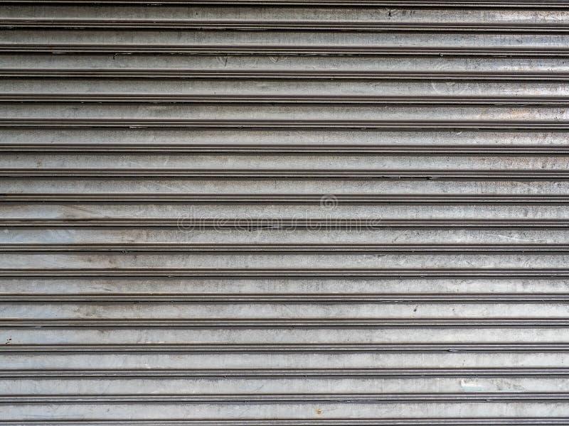 Rostfritt för dörrbakgrund för rullande slutare använda arkivbilder