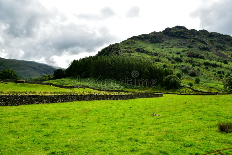Rosthwaite Cumbria around. Rosthwaite is a tiny hamlet used by walkers and climbers, as a base for exploring the beautiful surrounding countryside. On the royalty free stock images