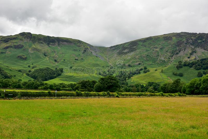 Rosthwaite Cumbria around. Rosthwaite is a tiny hamlet used by walkers and climbers, as a base for exploring the beautiful surrounding countryside. On the royalty free stock image