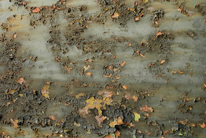 Rostig metallbakgrund för kanstött målarfärg royaltyfri fotografi