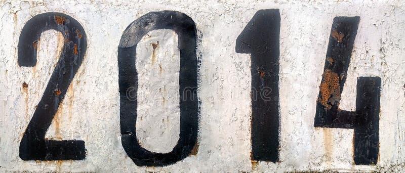 Rostig metallplatta med numret 2014 royaltyfri bild