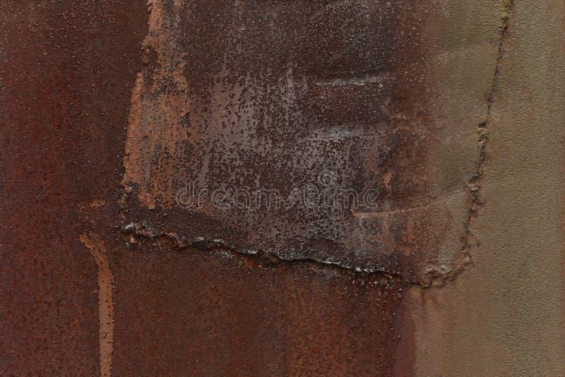 Rostig metallyttersida med svetsninglappen royaltyfri fotografi