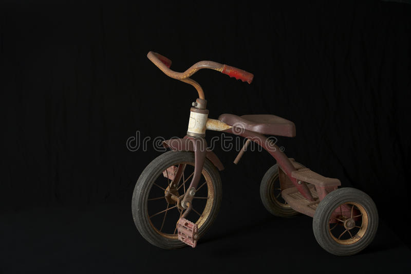 Rostiges Dreirad stockbilder