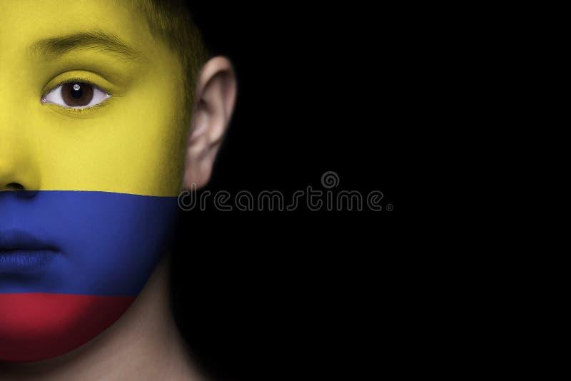 Rosto humano pintado com a bandeira de Colômbia foto de stock royalty free