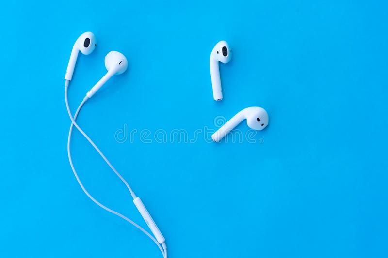 ROSTOV-ON-DON, RUSSIA - APRIL 28, 2018: comparison Apple AirPods wireless Bluetooth headphones and wired headphones Apple iPhone. stock photos