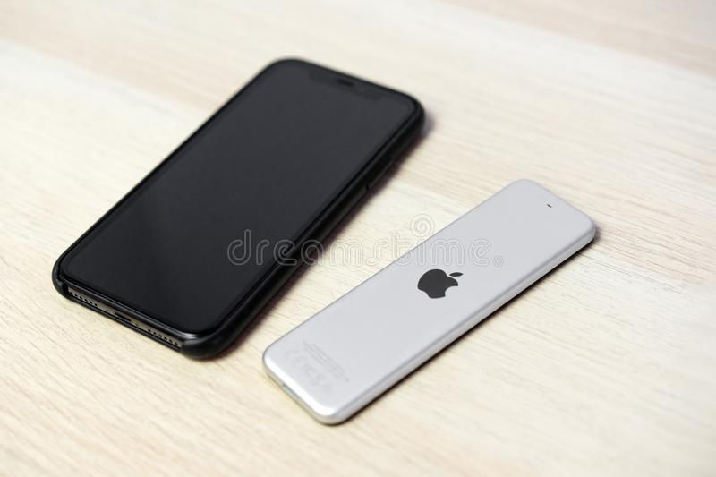 ROSTOV-ON-DON, RUSSIA - DECEMBER 20, 2018: New Apple TV media streaming  player microconsole by Apple Computers futuristic touch r. Emote swipe-to-select with stock image
