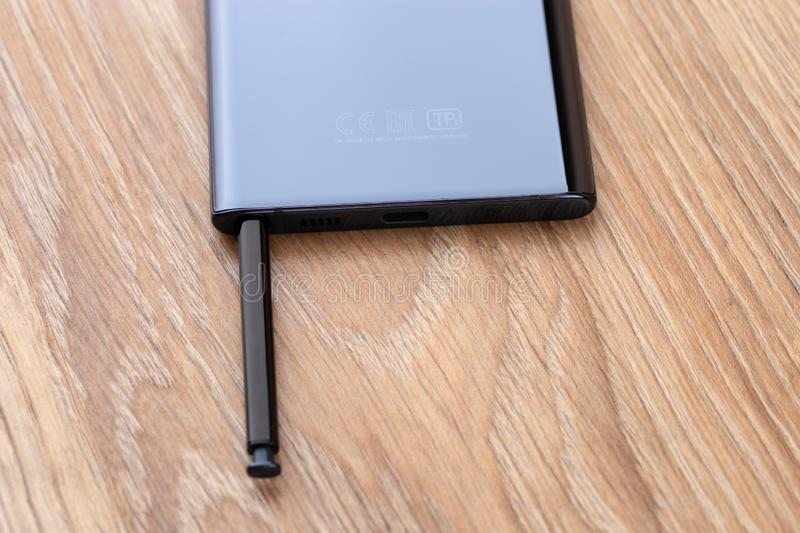 Samsung Galaxy Note 10 on a wooden table. stock image