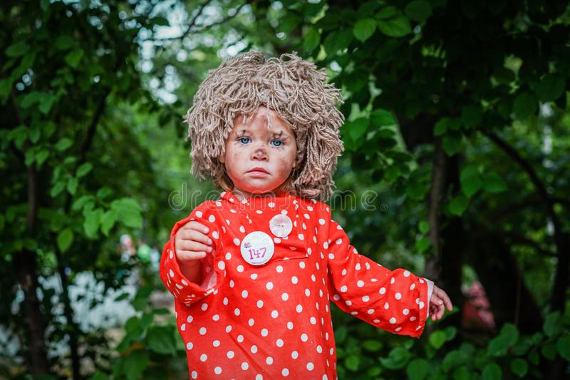 ROSTOV-ON-DON, RUSSIA - 20 May, 2018. Festival Ball of Babies. Beautiful little girl in festive dress and carnival mask Brownie.  stock photos